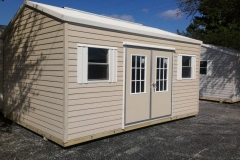 10x16 Beige and Cream w/FL Eave and Bahama Double Door