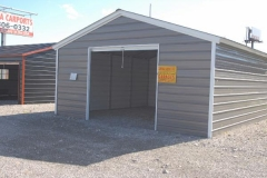 Enclosed Boxed Eave Carport with Roll-Up Door